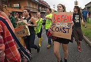 """New Orleans, LA,  September 21, 2013,  The environmental group 350.org's  """"Draw the Line"""" on Tar Sands and the Keystone XL  pipeline  protest  took  the form of a second line parade as it made its way through the french quarter .Over a hundred participants, including members of <br /> 350 NOLA, The Tulane Green Club , the Bucket Brigade,  and other environmental groups called out to  stop the Keystone XL pipeline as they marched and danced in the streets.  350.org's 'Draw the Line' campaign had over 200 events that took place across the country."""
