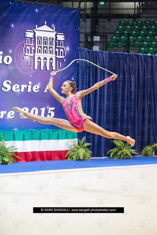 DESIO, ITALY - OCTOBER 31 2015: Francesca Majer of San Giorgio Desio performs with rope at the italian national rhythmic gymnastic championship. Her score in the apparatus is 15,700. Her team's score is 98,400 and ended up in second position.