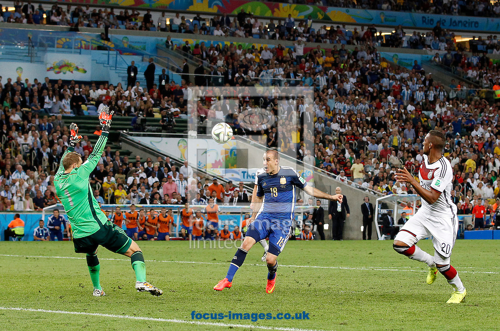 Argentina's Rodrigo Palacio lifts the ball over Germany's Manuel Neuer but his shot goes just wide during the 2014 FIFA World Cup Final match at Maracana Stadium, Rio de Janeiro<br /> Picture by Andrew Tobin/Focus Images Ltd +44 7710 761829<br /> 13/07/2014
