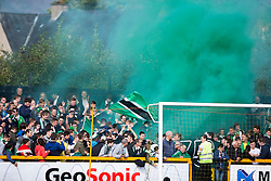 Hibernian's fans let off a flare at the start of the game.<br /> Alloa Athletic 2 v 1 Hibernian, Scottish Championship game played 30/8/2014 at Alloa Athletic's home ground, Recreation Park, Alloa.