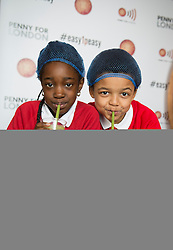 Image ©Licensed to i-Images Picture Agency. 06/03/2015. Leon, South Bank, London, United Kingdom. <br /> <br /> Children from Bellenden Primary School in Southwark, attend a Mayor's Fund for London Breakfast Club at Leon in central London where they put their maths skills to work to make healthy fruit smoothies.<br /> <br /> Picture by Ben Stevens / i-Images