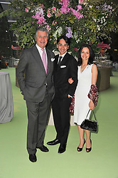 Left to right, ARNAUD BAMBERGER Executive Chairman Cartier UK and Managing Director Cartier UK FRANCOIS LE TROQUER and his wife LIUDMILA at a dinner hosted by Cartier in celebration of the Chelsea Flower Show held at Battersea Power Station, 188 Kirtling Street, London SW8 on 23rd May 2011.