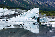 Reflection of ice in melt water at terminus of Matanuska Glacier in Southcentral Alaska. Spring. Afternoon.