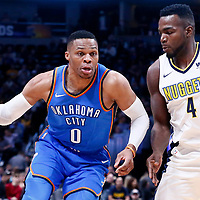 09 November 2017: Oklahoma City Thunder guard Russell Westbrook (0) drives past Denver Nuggets forward Paul Millsap (4) during the Denver Nuggets 102-94 victory over the Oklahoma City Thunder, at the Pepsi Center, Denver, Colorado, USA.