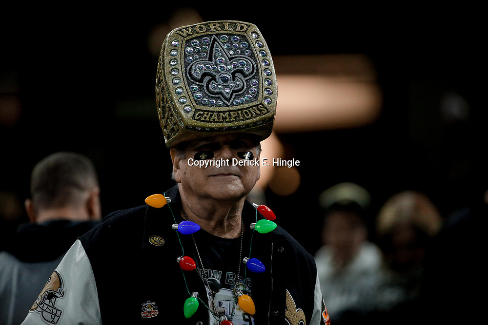 Dec 24, 2017; New Orleans, LA, USA; A New Orleans Saints fan wears a replica of the Super Bowl XLIV championship ring in the stands before a game against the Atlanta Falcons at the Mercedes-Benz Superdome. Mandatory Credit: Derick E. Hingle-USA TODAY Sports