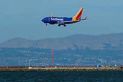 Boeing 737-7H4 (N743SW) operated by Southwest Airlines landing at San Francisco International Airport (KSFO), San Francisco, California, United States of America