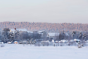 View of the small town of Inari, in Northern Finland, from the southern bank of Lake Inari, during sunrise on a February morning.
