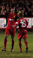 Photo: Leigh Quinnell.<br /> Tamworth v Stoke City. The FA Cup. 17/01/2006. Tamworths Nathan Jackson celebrates his goal with Eddie Anaclet.