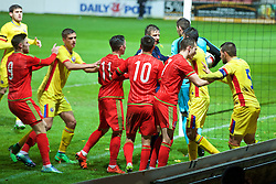 WREXHAM, WALES - Tuesday, November 17, 2015: Wales and Romania players clash after goalkeeper Laurentiu Branescu kicked Wales' Thomas O'Sullivan during the UEFA Under-21 Championship Qualifying Group 5 match at the Racecourse Ground. (Pic by David Rawcliffe/Propaganda)2