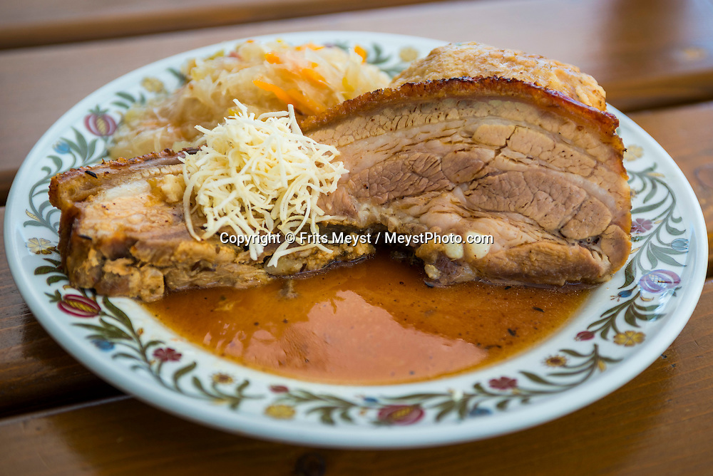 Melk, Danube, Lower Austria, September 2015. Schweinebraten mit Semmelknoedel.  Porkbelly with kraut and knoedel. Stift Melk is a Benedictine abbey above the town of Melk. Austria's most spectacular section of the Danube is the dramatic stretch of river between Krems an der Donau and Melk, known as the Wachau. Here the landscape is characterised by vineyards, forested slopes, wine-producing villages and imposing fortresses at nearly every bend. The Wachau is today a Unesco World Heritage site, due to its harmonious blend of natural and cultural beauty. Photo by Frits Meyst / MeystPhoto.com