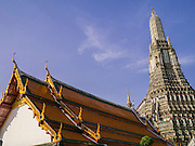 "19 OCTOBER 2012 - BANGKOK, THAILAND:    The roofline and prang of Wat Arun, the ""Temple of the Dawn"" in Bangkok, Thailand. Wat Arun is one of the most historic temples in Bangkok. It's Chedi is built in the Khmer (Cambodian) style and called a Prang.        PHOTO BY JACK KURTZ"