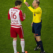 Nov 8, 2015; Harrison, NJ, USA; New York Red Bulls midfielder Sacha Kljestan (16) receives yellow card during the second half of the MLS Playoffs at Red Bull Arena. Mandatory Credit: William Hauser-USA TODAY Sports