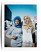 Piraeus Port, Greece, April 2016.<br /> <br /> I asked the subjects to pose but I did not direct the scene. The subjects decided where and how to pose. <br /> <br /> The original picture is a Polaroid Fujifilm FP-100C, which I re-photographed with Nikon 800 in my studio. Polaroid Camera: Polaroid 30 and Polaroid 103. The original picture can be provided upon request.
