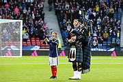 Piper plays Flower of Scotland while the mascot signs the words of the national anthem during the UEFA European 2020 Qualifier match between Scotland and Russia at Hampden Park, Glasgow, United Kingdom on 6 September 2019.