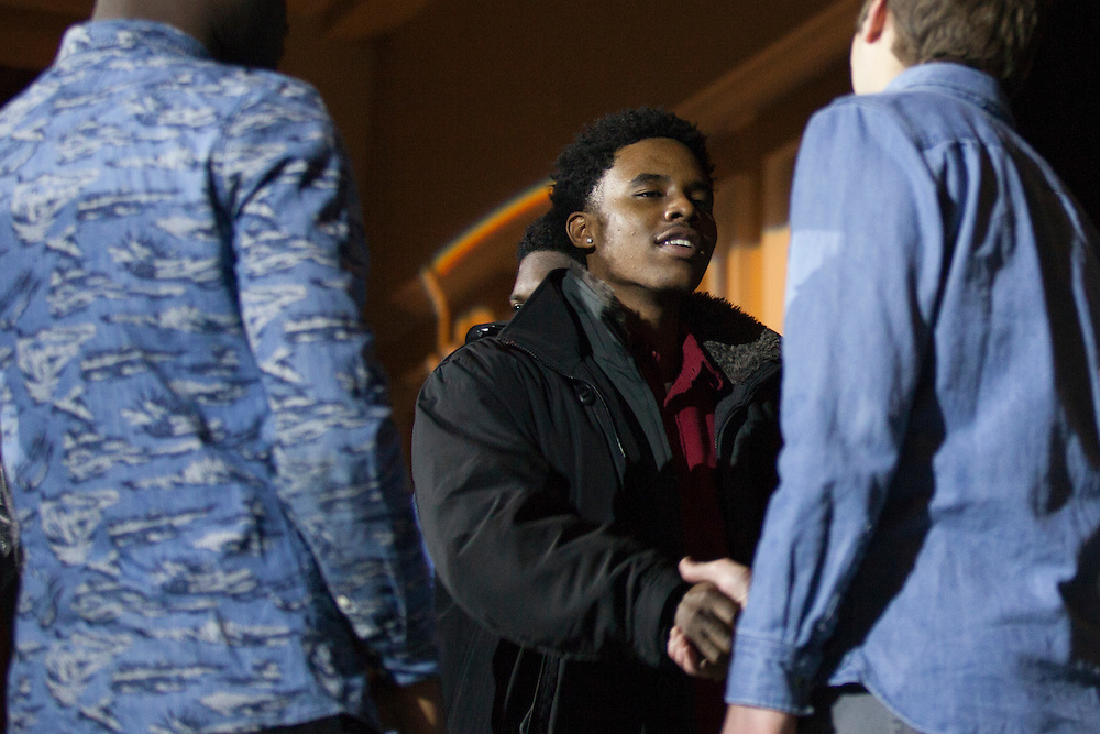 """Mulai Kamara, an electrical engineering student shakes hands with Michael Salopek, a music production student, after the  Black Student Cultural Programming Board's talent showcase """"Apollo Night's Best"""" on Friday, Feb. 5, 2016. Photo by Kaitlin Owens"""