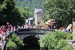 © Licensed to London News Pictures. 24/06/2018. Hebden Bridge UK. The Hebden Bridge Handmade parade is taking place today in Hebden Bridge, Yorkshire. The Handmade parade takes place in June each year & is a community made parade produced by local arts organisations to celebrate the creativity, variety & uniqueness of Hebden Bridge. Photo credit: Andrew McCaren/LNP