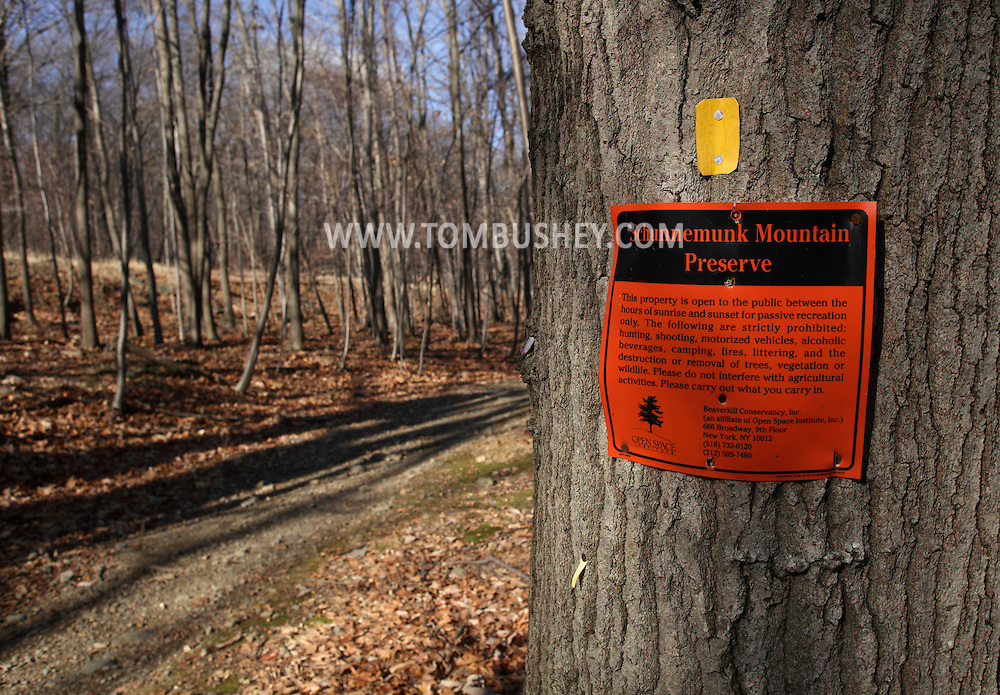 Mountainville, New York - A sign on a tree marks the Schunnemunk Mountain Preserve on  Nov. 28, 2010. The yellow trail marker on the tree is for the Jessup Trail.