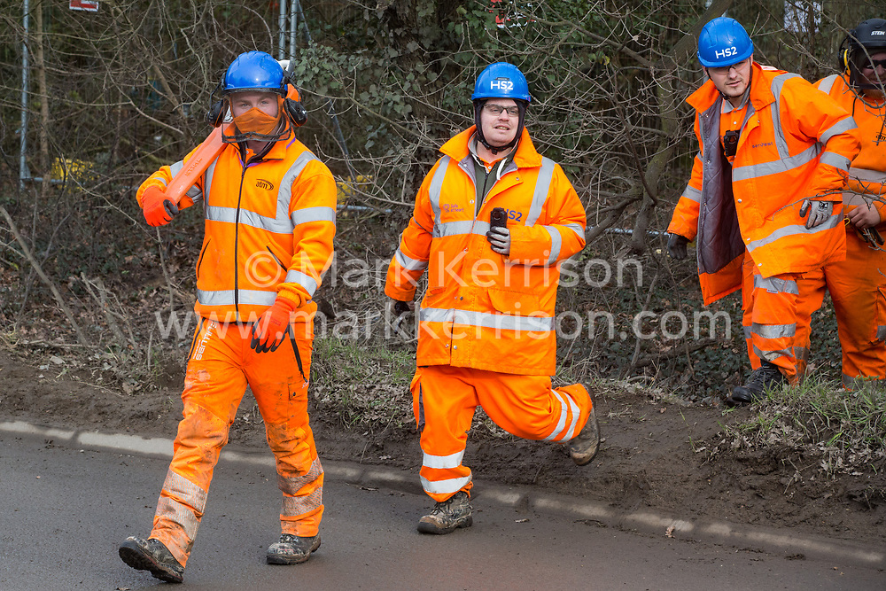 Harefield, UK. 8 February, 2020. HS2 engineers are forced to withdraw by environmental activists who prevented them from using a chainsaw to fell trees alongside Harvil Road in the Colne Valley. HS2 had scheduled tree felling work in the area for the high-speed rail project, implementing road and rail closures for this purpose, but no tree felling work was possible due to protective action from the environmental activists.
