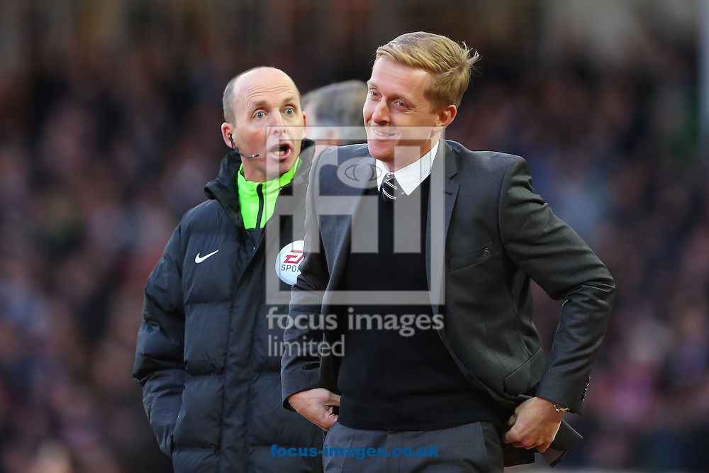 Manager of Swansea City, Garry Monk reacts after a conversation with fourth official, Mike Dean following the red card to Lukasz Fabianski of Swansea City during the Barclays Premier League match at the Boleyn Ground, London<br /> Picture by Richard Calver/Focus Images Ltd +447792 981244<br /> 07/12/2014