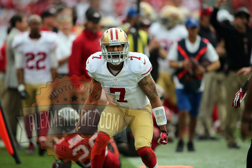 San Francisco 49ers quarterback Colin Kaepernick (7) screams after a big run  during an NFL football game between the San Francisco 49ers  and the Tampa Bay Buccaneers on Sunday, December 15, 2013 at Raymond James Stadium in Tampa, Florida.. (Photo/Alex Menendez)