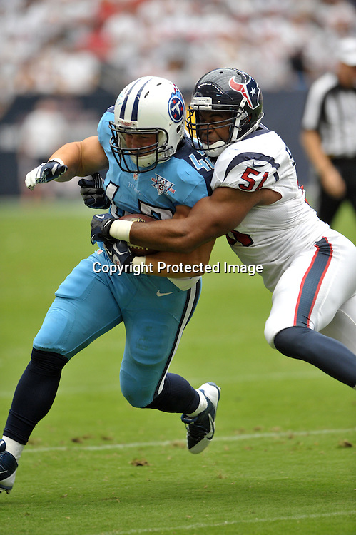 September 15 2013: Titans FB Collin Mooney(42) gets tackled by Darryl Sharpton(51) during 30 - 24 loss to the Texans at Reliant Stadium in Houston, TX.