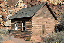 One-room Frutia Schoolhouse with colorful sandstone rock formations, Historic Fruita, Capitol Reef National Park, Utah, United States of America