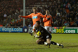 BLACKPOOL, ENGLAND - Tuesday, January 4, 2011: Blackpool's Luke Varney and Birmingham City's Ben Foster during the Premiership match at Bloomfield Road. (Pic by: David Rawcliffe/Propaganda)