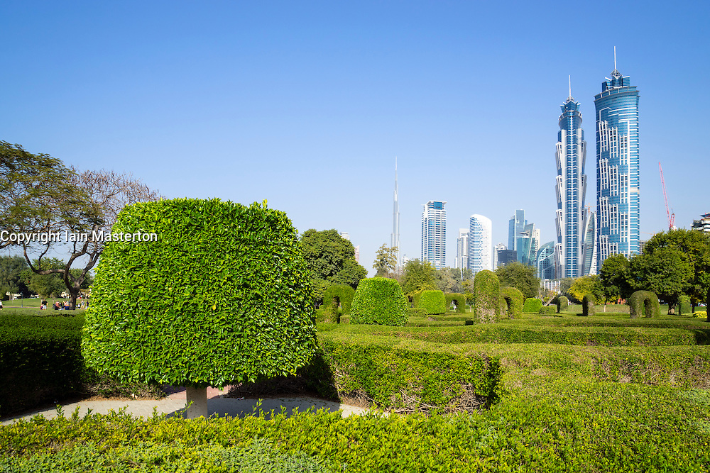 Skyline of Dubai from maze garden in  Al Safa Park in Dubai United Arab Emirates