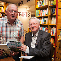 Paddty Moloney, from Kildysart, with Donncha O Dúlaing at the launch of his new book, Donncha's world, at the Ennis Bookshop
