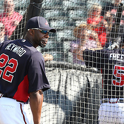 March 16, 2011; Lake Buena Vista, FL, USA; Atlanta Braves right fielder Jason Heyward (22) watches as teammate  Freddie Freeman (5) takes batting practice before a spring training exhibition game against the Boston Red Sox at the Disney Wide World of Sports complex. Mandatory Credit: Derick E. Hingle