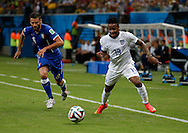 Raheem Sterling of England and Antonio Candreva of Italy during the 2014 FIFA World Cup match at Arena da Amazonia, Manaus<br /> Picture by Andrew Tobin/Focus Images Ltd +44 7710 761829<br /> 14/06/2014