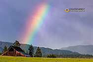 Rustic weathered barn with rainbow in Whitefish, Montana, USA