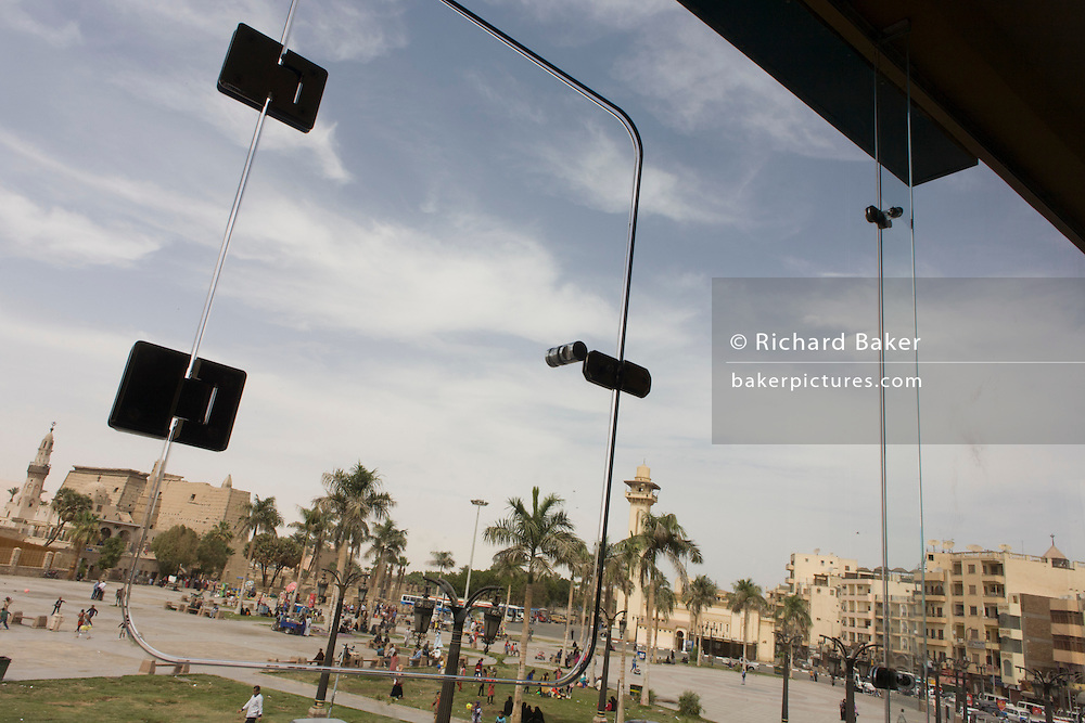 The main square opposite the ancient Egyptian Luxor Temple, Nile Valley, Egypt, seen through the window of a first storey cafe.