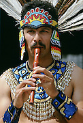Man in Mexican Aztec Indian outfit plays recorder, United States of America