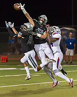 Granite Bay Grizzly's Jaylen Latson (21), and Granite Bay Grizzly's Ryan Fina (23), defined a pass intended for Folsom Bulldogs Elijhah Badger (14), during the first quarter as the Granite Bay Grizzly's varsity football team host the Folsom Bulldog's at Granite Bay High School, Friday Sep 29, 2017.<br /> photo by Brian Baer