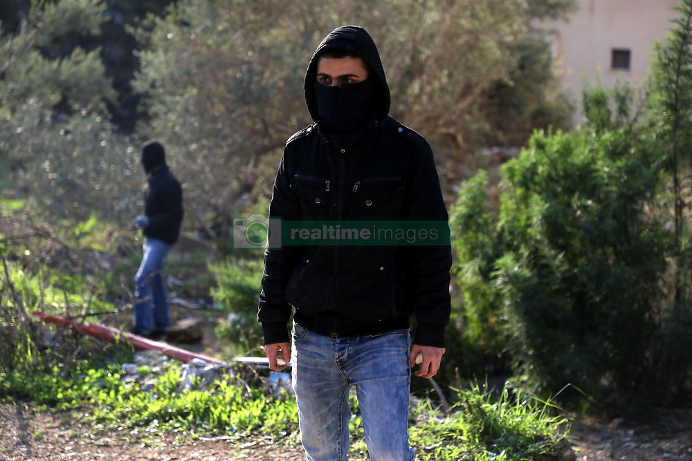 December 17, 2018 - Clashes occur between Palestinian youths and the Israeli forces in the Shweika village near Tulkarem on 17th December 2018,  as dozens of Israeli soldier raided the town. During the raid, the Israeli security forces demolished the family home of Ashraf Naalwa, a Palestinian suspected of carrying out a shooting attack killing two Israeli settlers in October. Naalwa was killed last Thursday by Israeli forces who surrounded the house where he was believed to be hiding, and shot and killed the man (Credit Image: © Mohammed Turabi/IMAGESLIVE via ZUMA Wire)