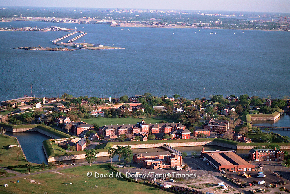 Aerial view of historic Old Point Comfort, site of Fort Monroe, Hampton Roads,   Virginia. Norfolk and Navy Base is across the water to the south. This site is at the mouth of the Chesapeake Bay and James River. The Route 64 Hampton Roads Bridge-Tunnel can be seen across the water on south side of Hampton Roads.