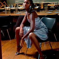 Fashion shoot , girl in chair .