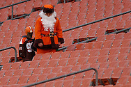 MORNING JOURNAL/DAVID RICHARD.Fans dressed in a Santa suit and a dog mask slowly walk through the stands at Cleveland Browns Stadium after the Browns' 41-0 loss to Pittsburgh.