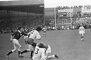Galway grabs onto Dublin player as two other players fall to the ground during the All Ireland Senior Gaelic Football Championship Final Dublin V Galway at Croke Park on the 22nd September 1974. Dublin 0-14 Galway 1-06.