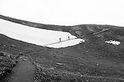 Foto von Bergwanderer im Schneefeld auf der Eigertrail