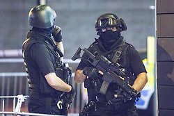 © Licensed to London News Pictures . FILE PICTURE DATED 23/05/2017 as Manchester prepares to mark a year since the Manchester Arena terror attack . Manchester, UK. Armed Police at Cathedral Gardens . Police and other emergency services are seen near the Manchester Arena after Salman Abedi murdered 22 and injured dozens more at an Ariana Grande concert at Manchester Arena. Photo credit : Joel Goodman/LNP