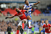 Reading's Nick Blackman and Charlton Athletic defender Zakarya Bergdich jump for the ball during the Sky Bet Championship match between Reading and Charlton Athletic at the Madejski Stadium, Reading, England on 17 October 2015. Photo by Mark Davies.