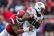 FAYETTEVILLE, AR - OCTOBER 24:  Stanton Truitt #10 of the Auburn Tigers and is tackled by Tevin Beanum #97 of the Arkansas Razorbacks at Razorback Stadium Stadium on October 24, 2015 in Fayetteville, Arkansas.  The Razorbacks defeated the Tigers in 4 OT's 54-46.  (Photo by Wesley Hitt/Getty Images) *** Local Caption *** Stanton Truitt; Tevin Beanum