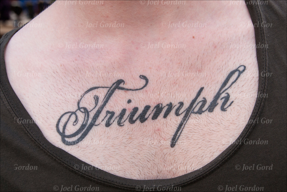 &quot;Triumph&quot; his chest tattoo.<br />