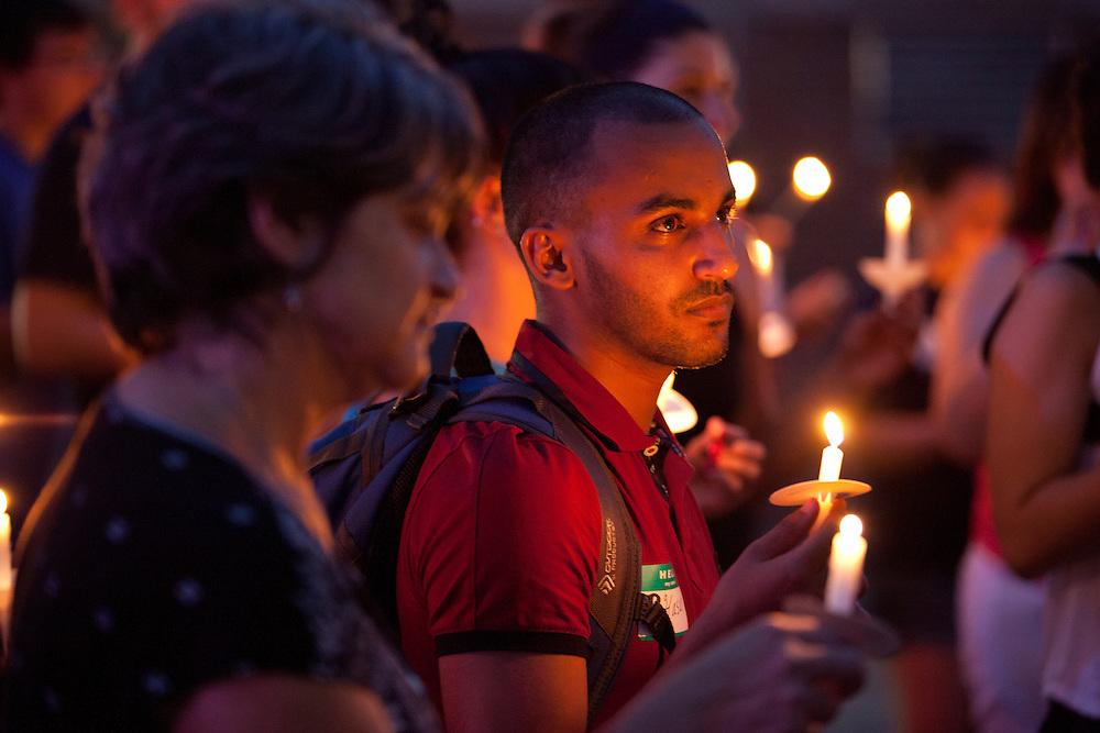 Wendy Lybarger of Athens (L) and student Hasan Alghamdi (R) at the United Campus Ministry's Interfaith Peace Walk at Ohio University on September 11, 2013. The walk eneded with a candlelight vigil at the Islamic Center on 13 Stewart Street.