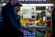 WASHINGTON, USA - August 19: A woman looks out at people walking by from her food booth at the Montgomery County Agricultural Fair in Gaithersburg, Md., USA on August 19, 2017.