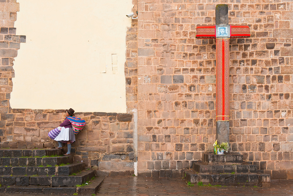 South America, Andes, Peru,Cusco, native woman passing church