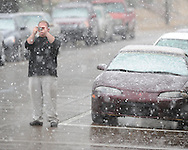 Danny Watson photographs snow falling in Oxford, Miss. on Sunday, March 21, 2010.