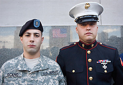 This photo was a gift to General David Petraeus. These two young men are standing in front of a marble wall as they look at Ground Zero. The poignant nature of this image is not what is shown but what is lacking. The reflection of the US flag is visible because the twin towers were no longer standing. The two young men are facing the hole where the two buildings stood on the fifth anniversary of the collapse. It poses the question would these two young men have been in uniform had it not been for the loss of these two buildings and the thousands that died that day?